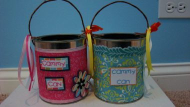 """Two decorated """"Cammy Can"""" cans used for fundraising. / Rett Syndrome News"""
