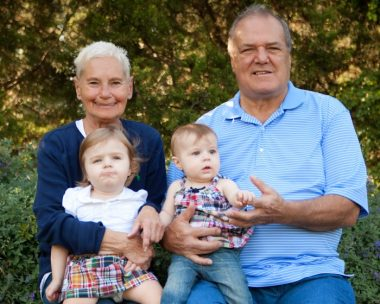 Symptoms / Rett Syndrome News / Photo of Cammy and Ryan sitting on their grandparents' laps.