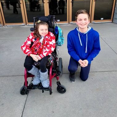 Life events and Rett syndrome | Rett syndrome News | Oliver kneels beside Cammy at her 12th birthday party