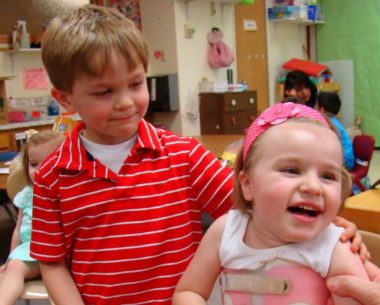 Life events and Rett syndrome | Rett syndrome News | Oliver puts his arm around Cammy's shoulder in their preschool classroom